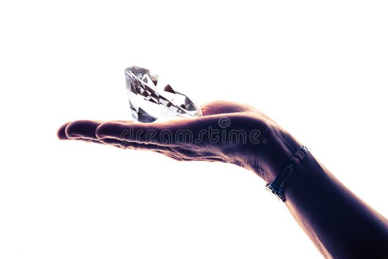 Diamant på handen royaltyfria foton