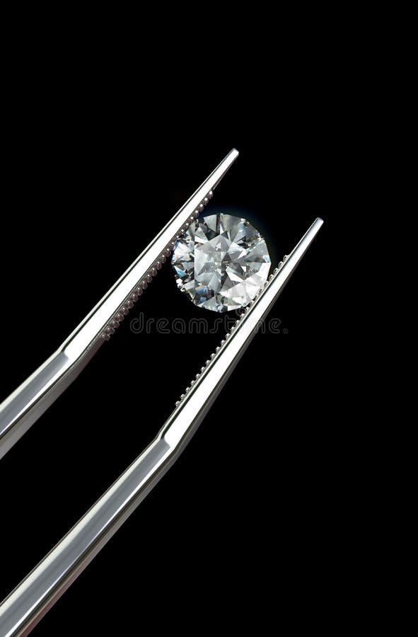 Diamant retenu par des brucelles illustration libre de droits