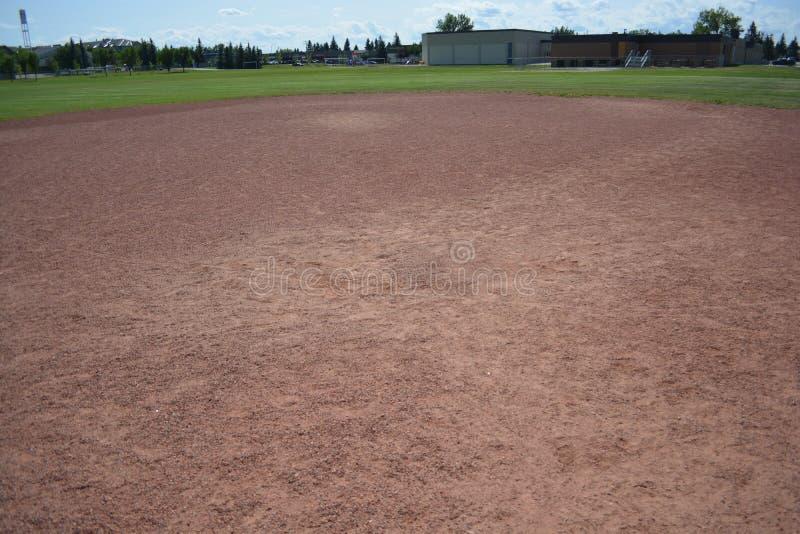 Diamante do campo de Basefield em um parque de comunidade local imagem de stock
