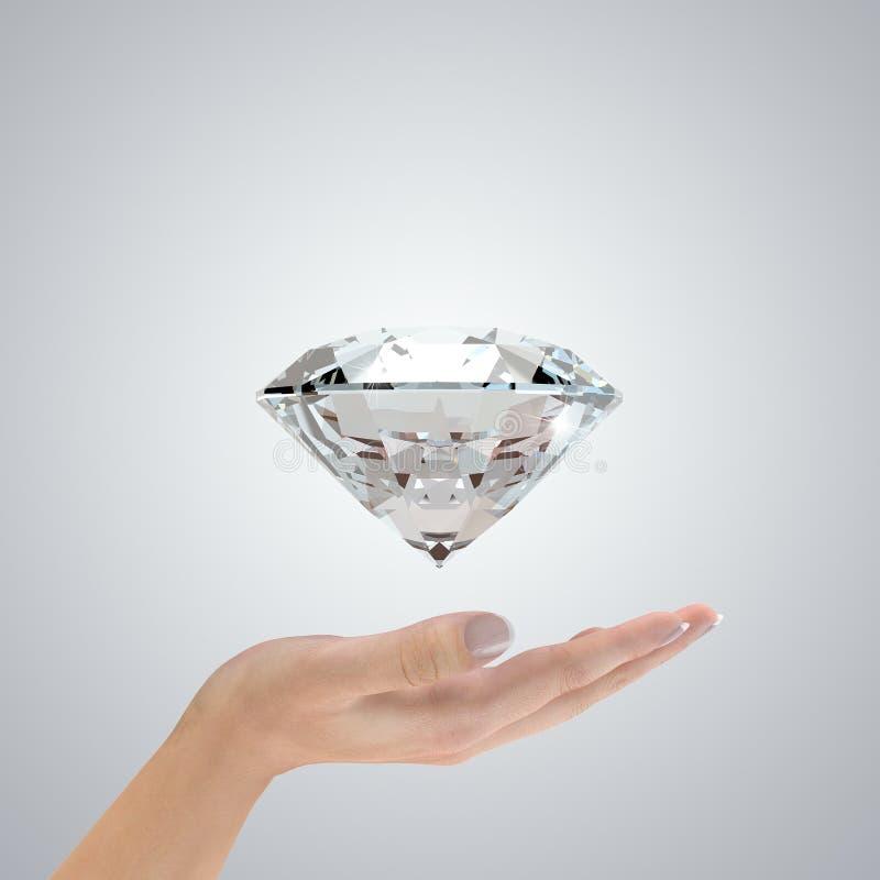Diamante in mani fotografie stock