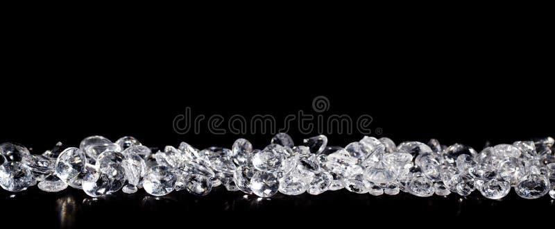 Diamanten op zwarte achtergrond stock afbeeldingen