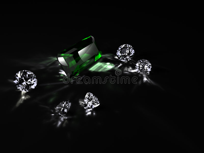 Diamanten und ein Smaragd stockbild