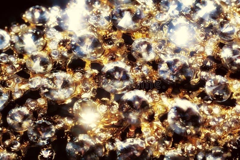 Diamanten und Goldmakro stockfoto