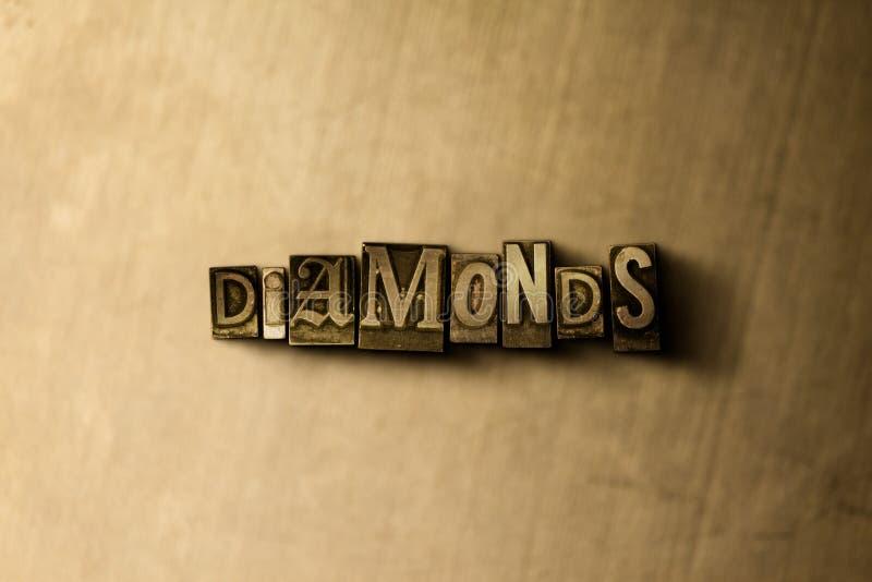 DIAMANTES - close-up vintage sujo da palavra typeset no contexto do metal fotografia de stock royalty free