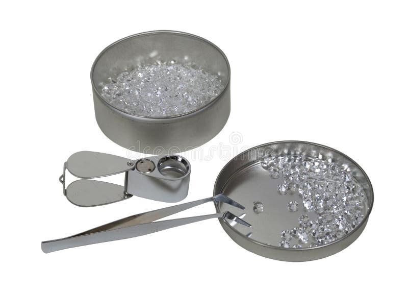 Diamantes com lupa e Tweezers imagem de stock