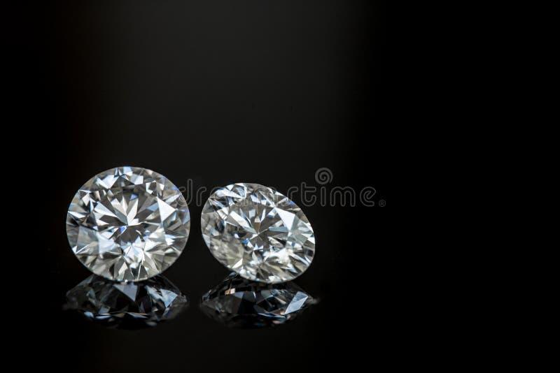 Diamanti su priorità bassa nera immagini stock