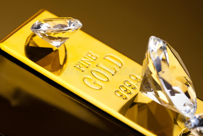 Diament i złoto, nastrojowy pieniężny pojęcie fotografia royalty free