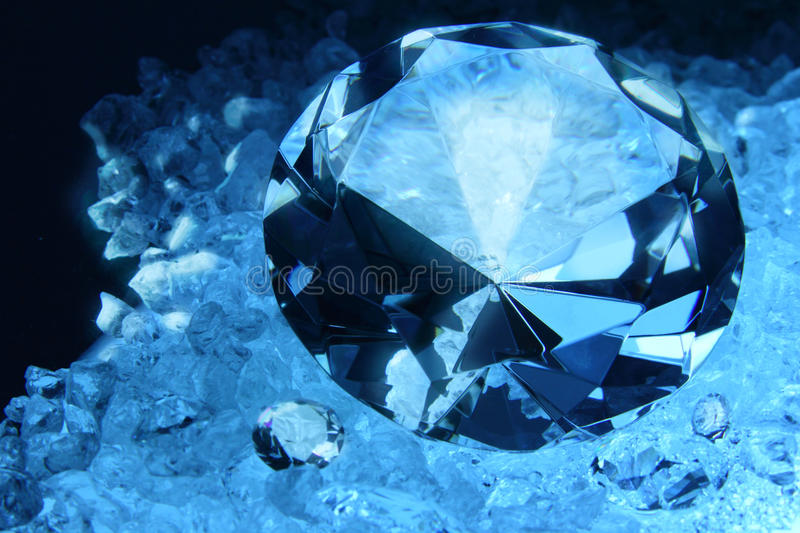 Diamond. Crafted diamond in deferent sizes with raw diamond background royalty free stock images