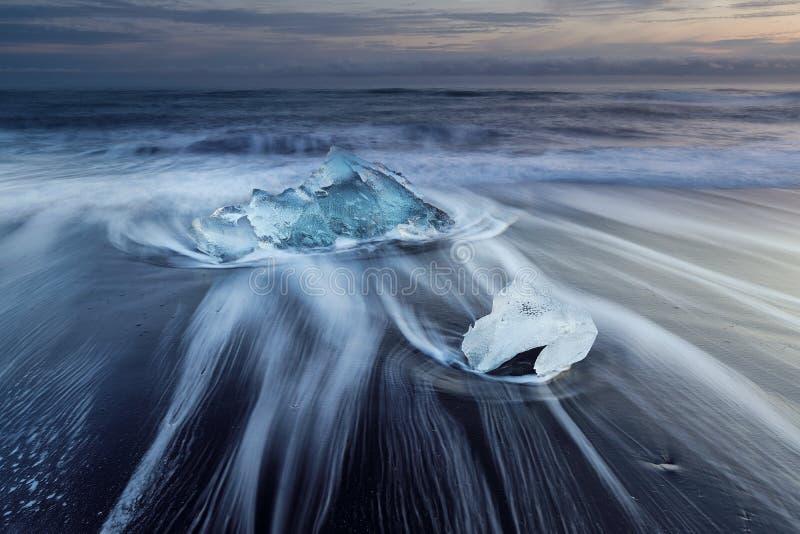 Diamond beach, ice blocks in a black sand beach. Diamond beach, ice blocks in a black beach stock photography