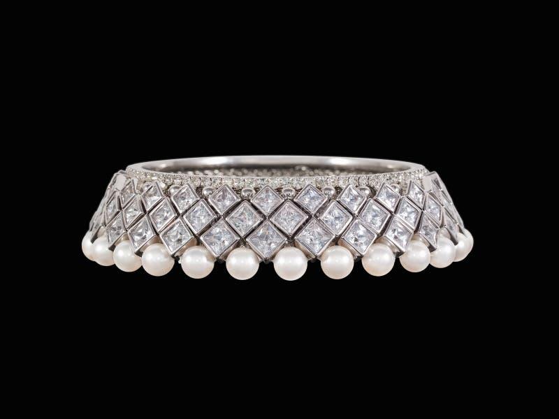 Diamond bracelet. Luxury lady's pearls and diamonds bracelet on black background stock photography