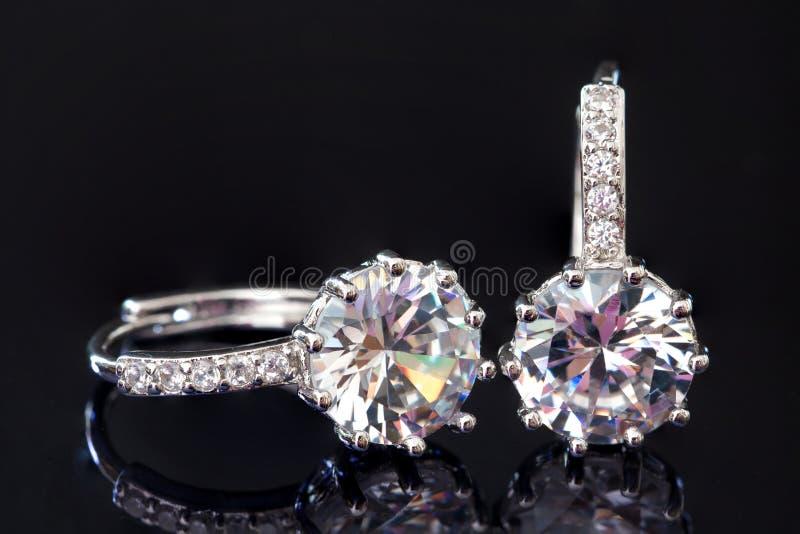 Diamond earrings jewelry, luxury silver earrings with diamond, sapphires in black background. Diamond earrings jewelry luxury silver earrings with diamond stock image