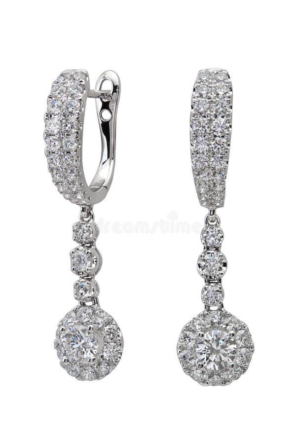 Diamond earrings on white royalty free stock images