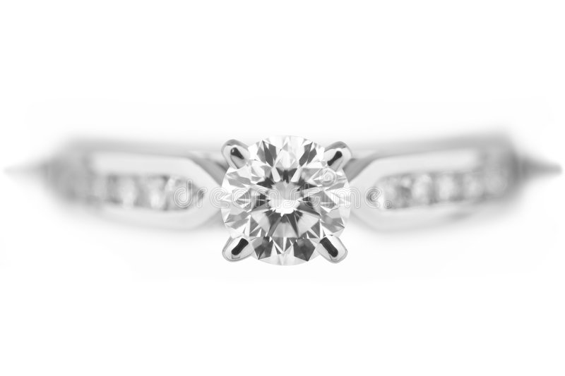 Diamond Engagement Ring. Extreme close up of a platinum diamond engagement ring royalty free stock image