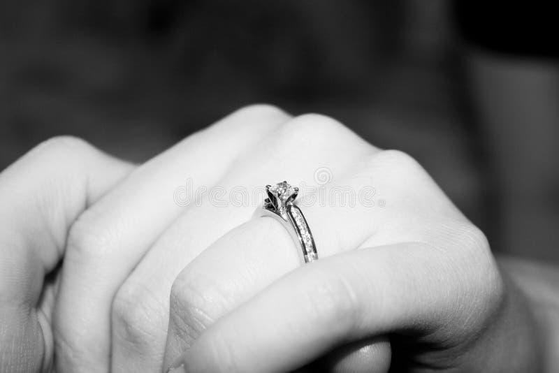Diamond Engagement Ring. Platinum diamond engagement ring on lady's finger royalty free stock photos