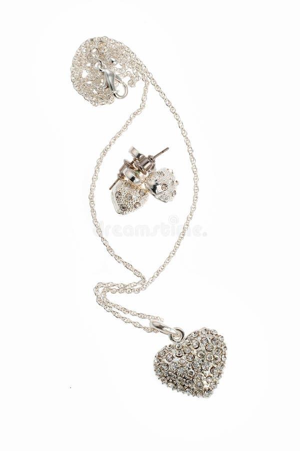 Diamond heart and earring royalty free stock photo