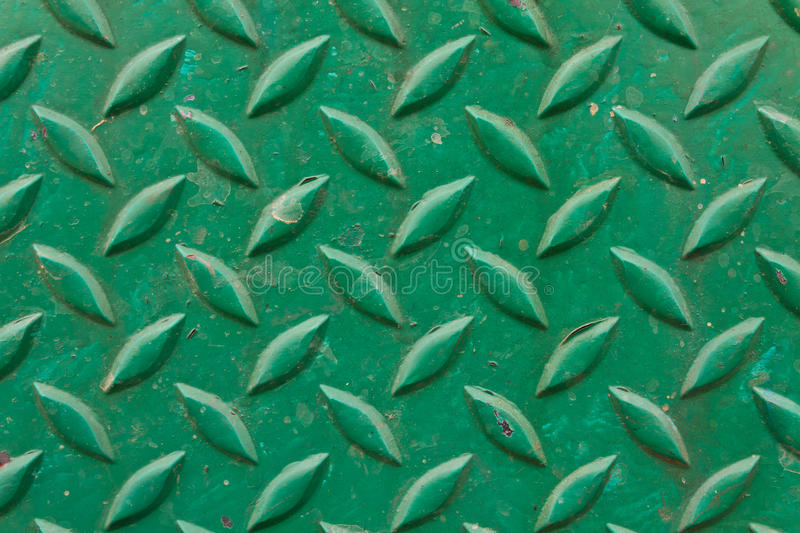 Diamond metal painted green. On piece of background stock photography