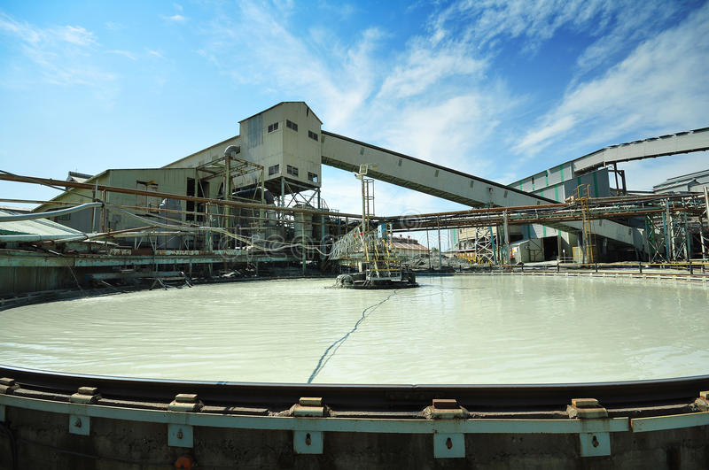 Diamond mine thickener. A large thickener tank in use at a diamond mine, slowly circulating the water suspension stock photography