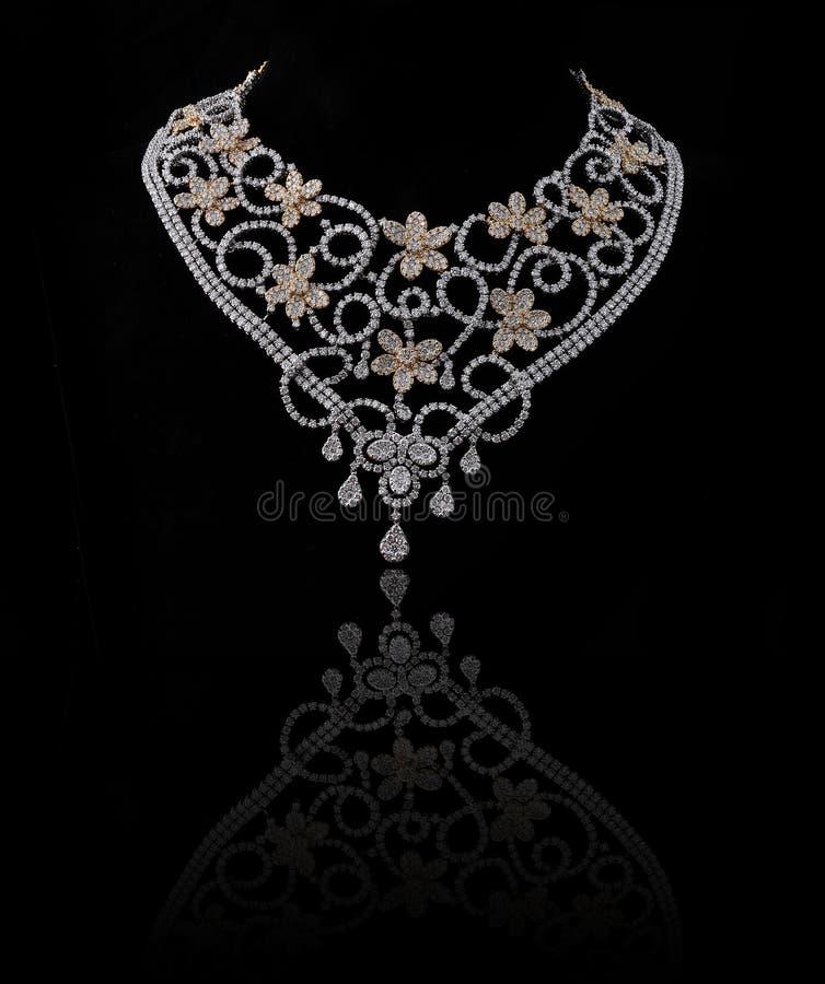 Diamond necklace. On black background stock photos