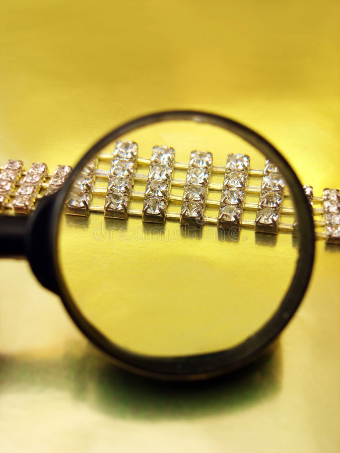 Diamond necklace. Find the diamond necklace with magnifying glass stock image