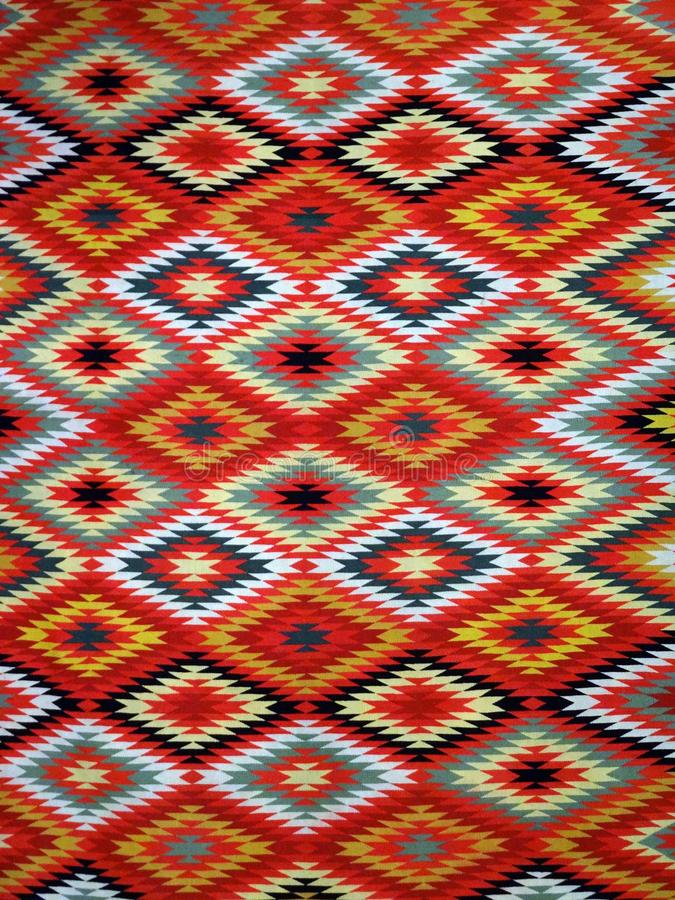 Diamond pattern Blanket Rug. Pattern Red, Orange, White, Green, Black, and blue Diamond Blanket/ Rug - Navajo Artist, made about 1885 of cotton and wool royalty free stock photo