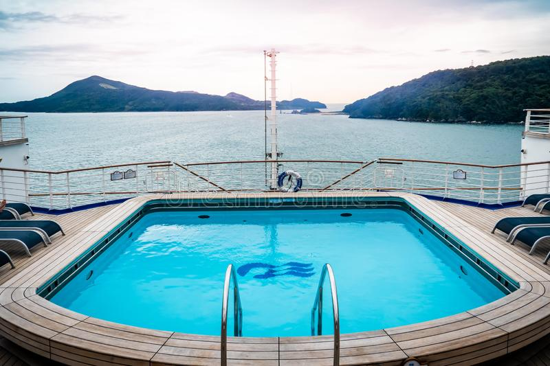 Diamond princess cruise ship with service Bar and Swimming pool with the view of Toba island in background stock photography