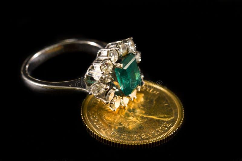 Diamond ring with big emerald stock photo