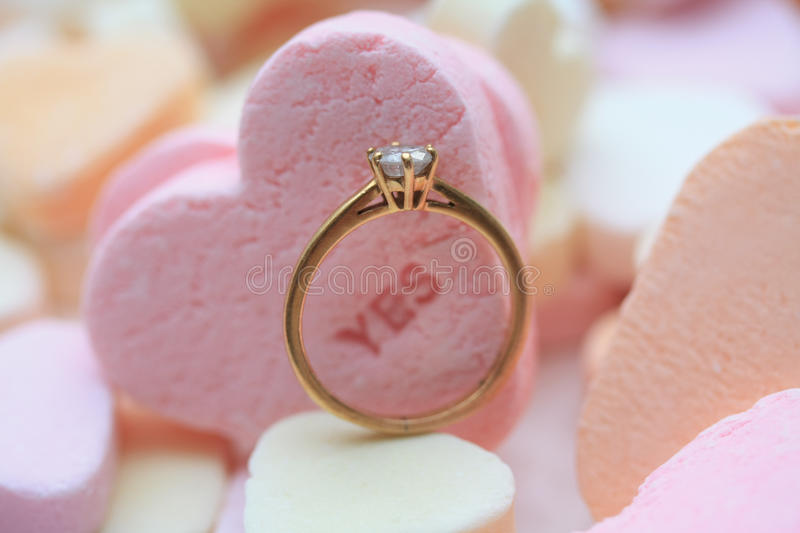 Download Diamond Ring And Candy Hearts Stock Image - Image: 12477329