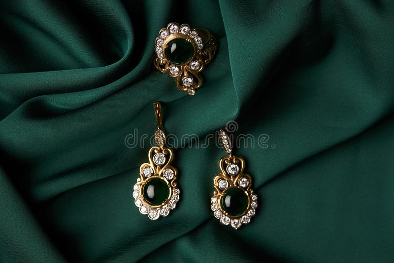 Download Diamond Ring And Earrings With Emerald Stock Photo