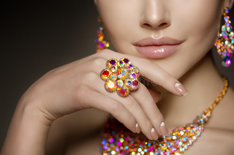 Diamond ring on the hand of a beautiful woman. Brilliant. Antiq royalty free stock photo
