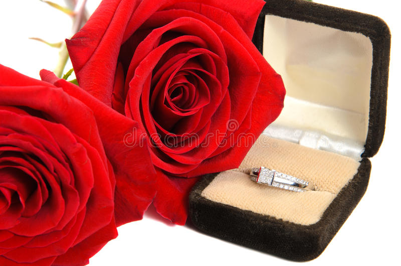 Diamond Ring Next To Two Red Roses Stock Photography