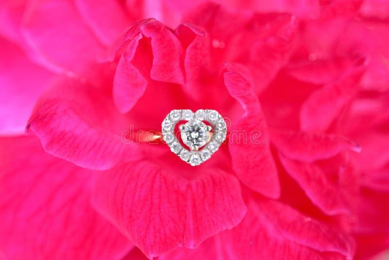 Diamond ring with pink rose stock photos