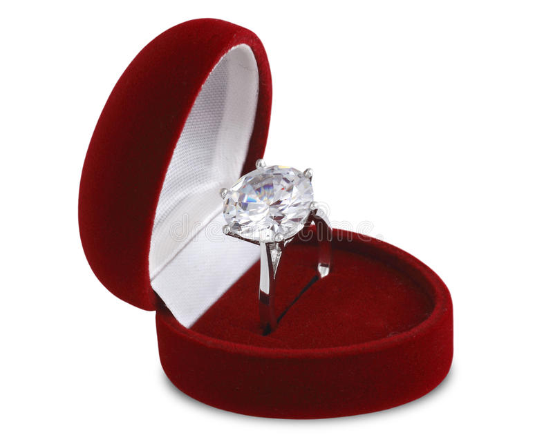Diamond ring in red velvet box stock image