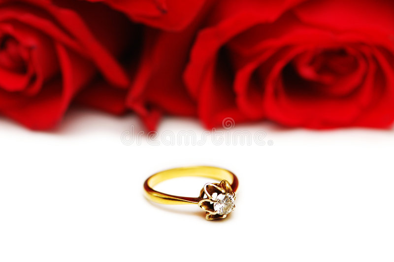 Diamond ring and roses royalty free stock photo