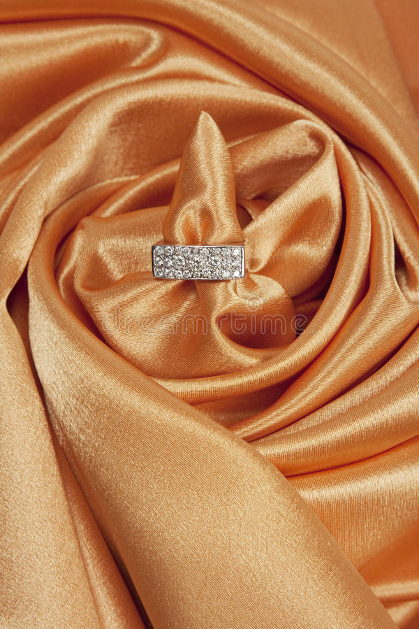 Diamond ring on silk background royalty free stock images