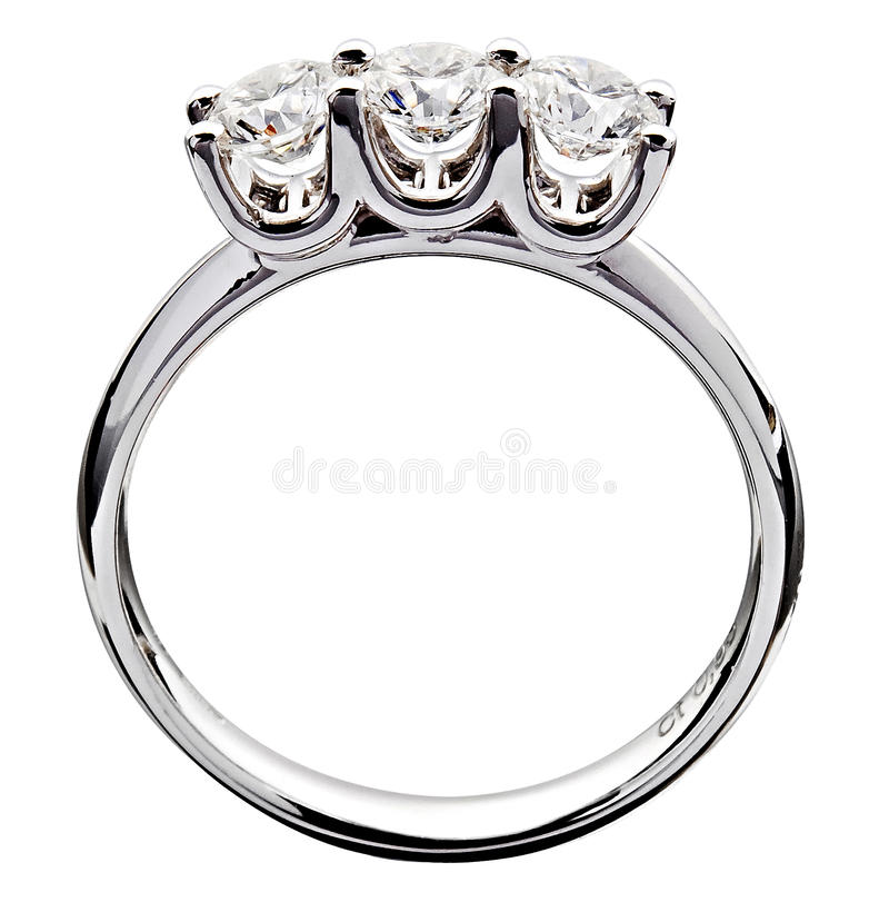 Diamond ring with a trilogy set in silver metal. Close up side view of a romantic diamond gemstone ring with a trilogy of stones set in silver metal symbolising royalty free stock photos