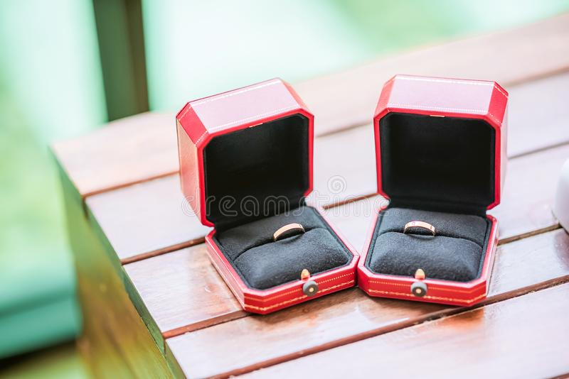 Diamond ring, wedding ring, Wedding Ring bride price. Wedding symbols. Wedding ceremony. Image for objects and article.rings on wooden surface, symbol of stock photo