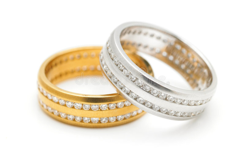 Diamond rings. A pair of silver and gold diamond rings royalty free stock image