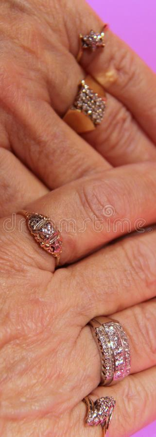 Diamond rings on hands royalty free stock photography