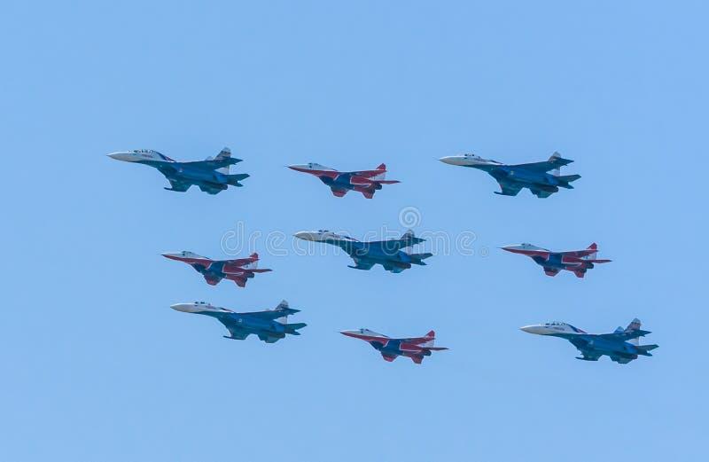 Diamond-shape of 4 Mig-29 and 5 Su-27 Swifts royalty free stock photos
