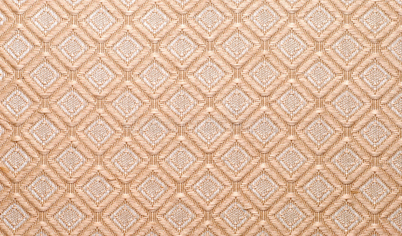 Diamond shaped design on fabric stock images