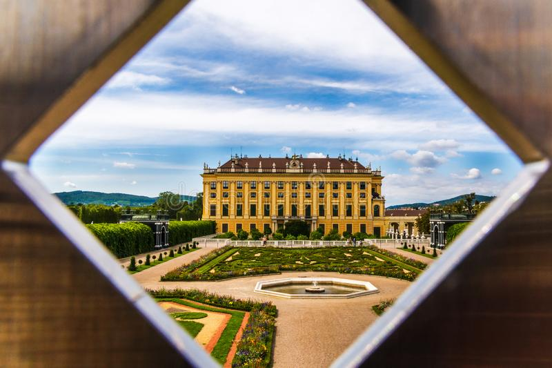Diamond shaped hole view of majestic Schonbrunn palace, Vienna Austria stock photos