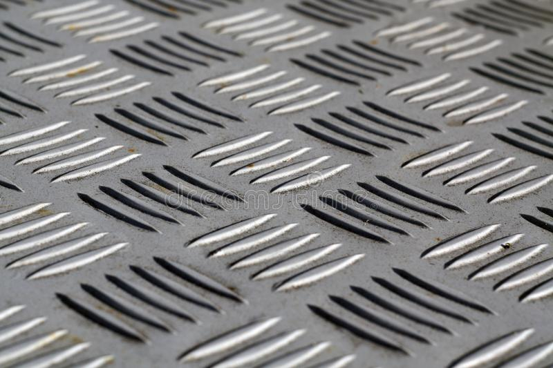 Diamond shaped metal floor pattern with blur effect. stock photos