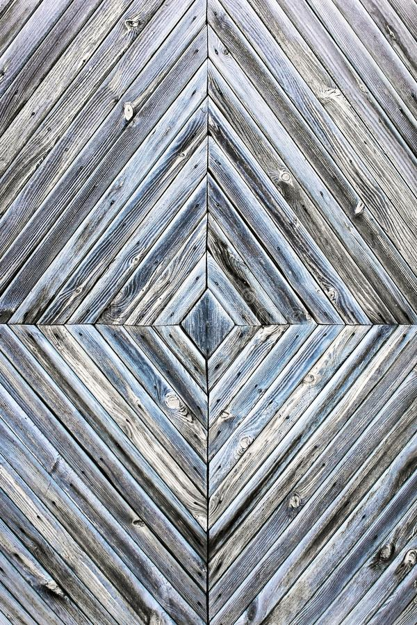 A diamond-shaped pattern of the old wooden boards, grey blue background texture royalty free stock photography