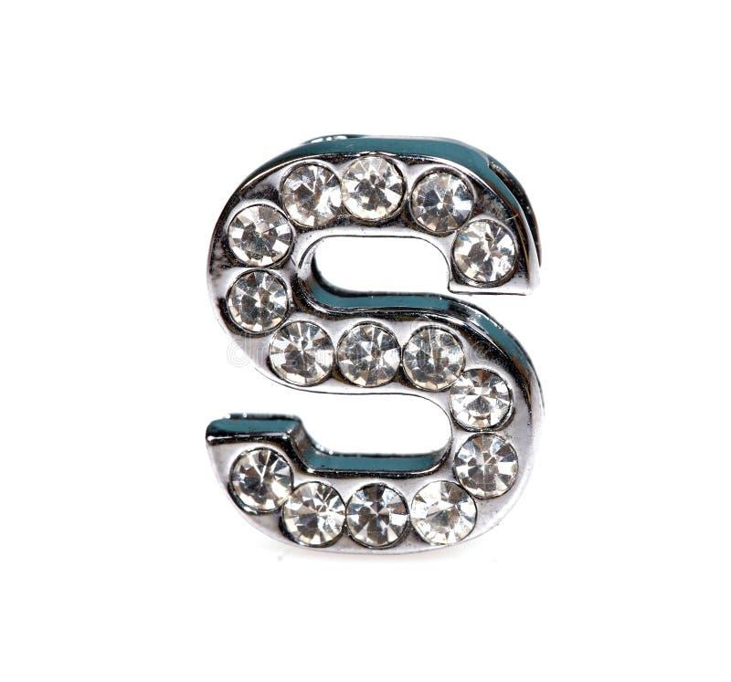 Diamond studded pendant jewellery. Diamond studded letter's' pendant jewellery on white background royalty free stock images