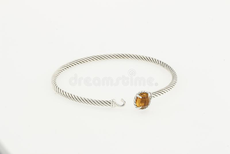 Diamond Tennis Bracelet, Pave Cross Bracelet with Diamonds, Cable Collectibles Evil Eye Bracelet with Diamonds and Light Blue stock image