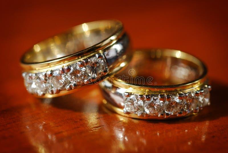 Diamond wedding rings. Two diamond wedding rings on a table stock photography