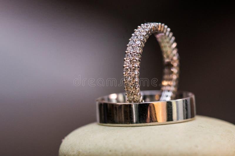 Diamond wedding rings. Relationship, commitment, love stock photography