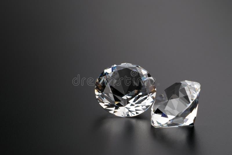 Diamonds on black background copyspace.  stock image