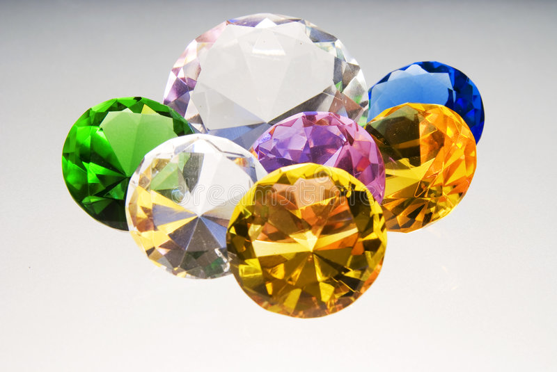 Diamonds are forever. Some colored gemstones on a white backround royalty free stock image
