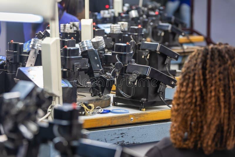 Diamonds polishing factory. Machines to polish diamonds, grading diamonds, african woman working. In Africa , Botswana royalty free stock photos